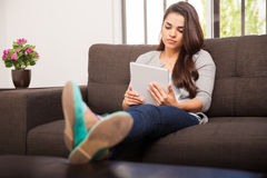Reading ebook on a tablet Royalty Free Stock Image