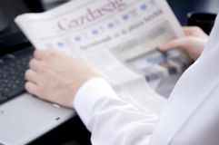 Reading the economical news. (blurred image Royalty Free Stock Photo
