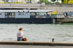 Reading in edges of the Seine. In Paris Stock Photo