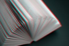 Reading and education concept. Sheets of book full of mysteries, stories and plots - image with glitch effect stock images