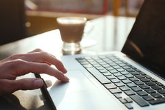 Reading emails in cafe. Using computer, check e-mail in the morning royalty free stock images