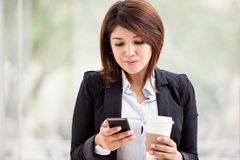 Reading emails on a cell phone Stock Photos