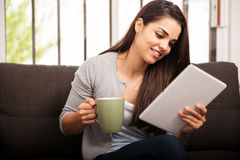 Reading and enjoying coffee Stock Images