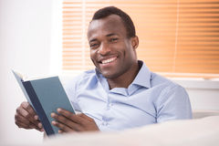 Reading an exciting book. Royalty Free Stock Photography