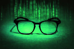 Reading eyeglasses absorb binary data , concept of future knowl Stock Images