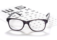 Reading eyeglasses and eye chart close-up Royalty Free Stock Image
