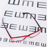 Reading eyeglasses and eye chart Stock Photography