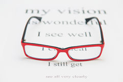 Reading eyeglasses and eye chart Royalty Free Stock Photo