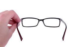 Reading eyeglasses in hand Royalty Free Stock Photo