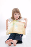 Reading fairy tales. Little girl reading fairy tales on white background Royalty Free Stock Photography