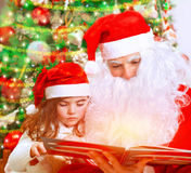 Reading fairytale with Santa Claus Stock Images