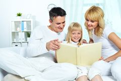 Reading family Stock Images