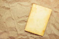 Reading favourite classic old book on summer vacation beach holi. Day, top view of a book cover as copy space in warm beach snow Stock Photography
