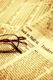 Reading financial news Stock Photo