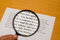 Reading the fine print Royalty Free Stock Images