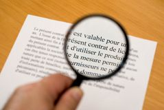 Reading fine print in French Royalty Free Stock Images