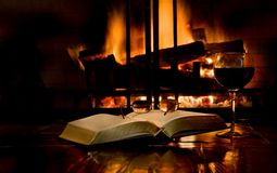 Reading by firelight Stock Photography