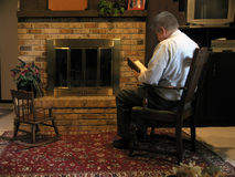 Reading by Fireside stock images