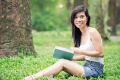 Reading in the forest Stock Photography