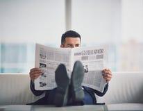 Reading fresh news Stock Images