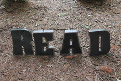 Reading is fun. Found in the garden at storybook gardens Royalty Free Stock Photography