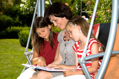 Reading in garden Royalty Free Stock Photography