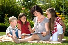 Reading in garden Royalty Free Stock Photos