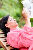 Reading garden woman Royalty Free Stock Photography