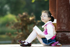 Reading girl. The girl read a book outside royalty free stock photography