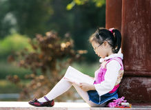 Reading girl. The girl read a book outside stock photography