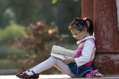 Reading girl. The girl read a book outside stock image