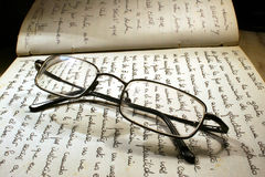 Reading Glasses. Glasses on handwritten book Royalty Free Stock Photos