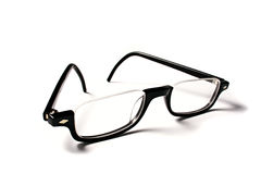 Reading Glasses. Black reading glasses on white background royalty free stock image