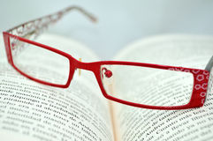Reading Glasses. On an open book Stock Photo