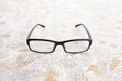 Reading glasses. On paper background Stock Photography