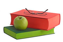 Reading Glasses. Books with green apple an reading glasses - isolated on white background Stock Photography