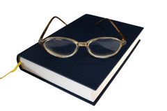 Reading glasses. On  book isolated on white Stock Images