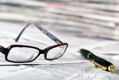 Reading glasses and ballpoint pen Royalty Free Stock Photo