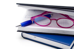 Reading glasses and ballpoint pen Stock Image