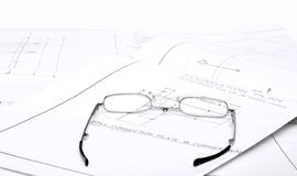 Reading Glasses on blueprints Stock Images