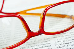 Reading glasses on book Stock Photo