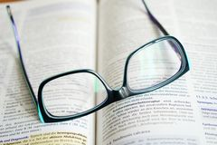 Reading Glasses On A Book  Stock Images