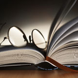 Reading glasses on the book royalty free stock images