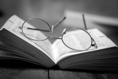 Reading glasses on a book. Royalty Free Stock Image