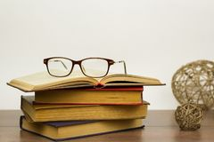Reading glasses are on the book. royalty free stock image