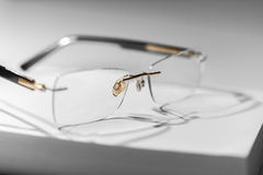 Reading glasses on book. Sparse image with reading glasses on book Stock Images