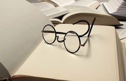 Reading glasses and books royalty free stock photos