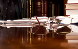 Reading glasses on desk Royalty Free Stock Photos