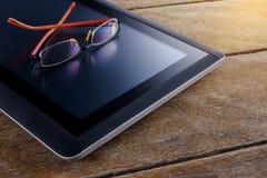 Reading glasses on digital tablet pc Stock Photo