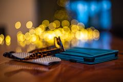 Reading glasses and e-reader on walnut table with bokeh stock photos